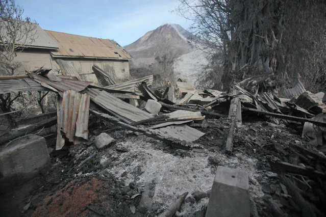A scorched home is seen after it was hit by pyroclastic flow from the eruption of Mount Sinabung in Gamber village, North Sumatra, Indonesia, Sunday, May 22, 2016. (Photo by Binsar Bakkara/AP Photo)
