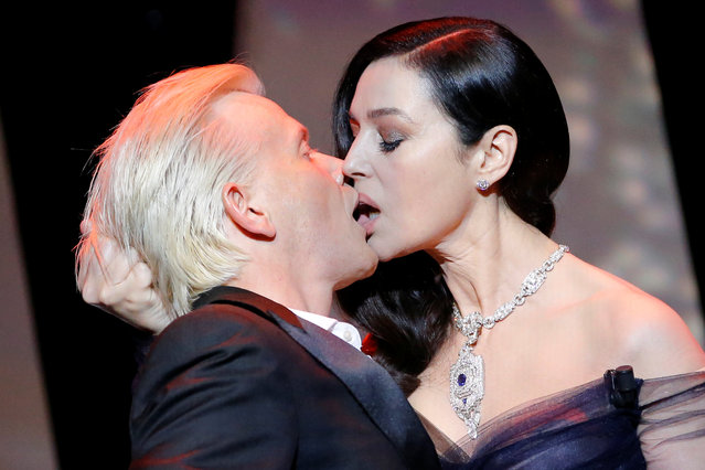 Italian actress and master of ceremonies Monica Bellucci (R) and French comedian Alex Lutz kiss as they perform on stage on May 17, 2017 during of the opening ceremony of the 70 th edition of the Cannes Film Festival in Cannes, southern France. (Photo by Stephane Mahe/Reuters)