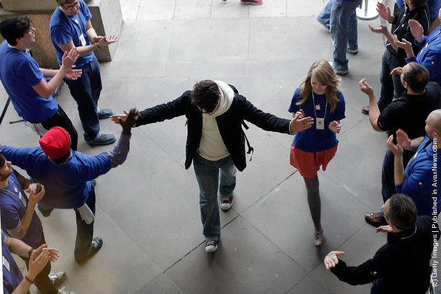 A shopper is welcomed into the Apple Store by staff in Covent Garden to buy a new iPad on March 16, 2012 in London