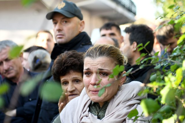 Relatives of people living at a collapsed building cry in Thumane, 34 kilometres (about 20 miles) northwest of capital Tirana, after an earthquake hit Albania, on November 26, 2019. Albanian rescuers were digging through rubble in search of survivors on November 26, 2019, after the strongest earthquake in decades claimed at least 13 lives, with victims trapped in the debris of toppled buildings. The 6.4 magnitude quake struck at 3:54 am local time (0254 GMT), with an epicentre 34 kilometres (about 20 miles) northwest of the capital Tirana in the Adriatic Sea, according to the European-Mediterranean Seismological Centre. (Photo by Gent Shkullaku/AFP Photo)