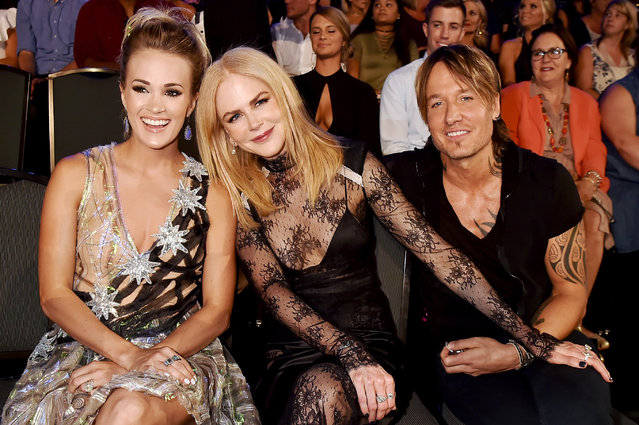 (L-R) Carrie Underwood, Nicole Kidman and Keith Urban in the audience during the 2017 CMT Music Awards at the Music City Center on June 7, 2017 in Nashville, Tennessee. (Photo by Jeff Kravitz/FilmMagic)