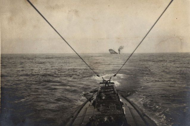A German U-boat sinks an Allied merchant vessel in the Atlantic Ocean in this 1915 handout picture. This picture is part of a previously unpublished set of World War One (WWI) images from a private collection. The pictures offer an unusual view of varied and contrasting aspects of the conflict, from high tech artillery to mobile pigeon lofts, and from officers partying in their headquarters to the grim reality of life and death in the trenches. The year 2014 marks the centenary of the start of the war. (Photo by Reuters/Archive of Modern Conflict London)