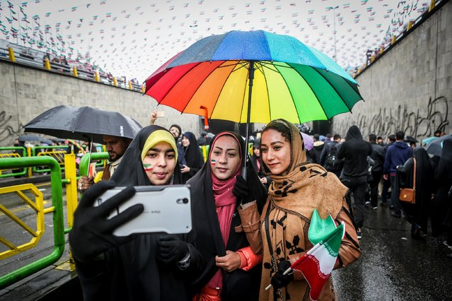 An Iranian woman takes selfies during a ceremony to mark the 40th anniversary of the Islamic Revolution in Tehran, Iran on February 11, 2019. (Photo by Vahid Ahmadi/Tasnim News Agency via Reuters)