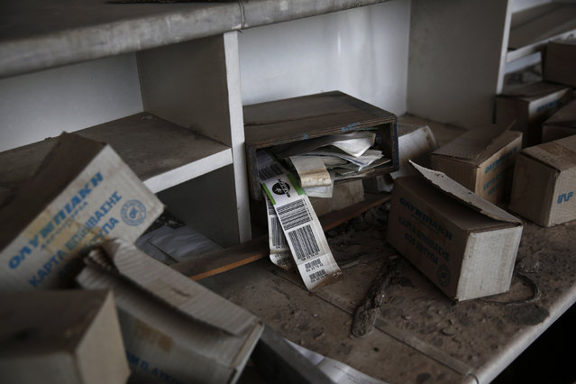 Olympic Airways travel tags are seen behind a desk inside the west terminal of the former Athens International airport, Hellenikon June 16, 2014. (Photo by Yorgos Karahalis/Reuters)