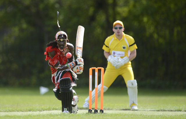 "Nissan Jonathan Ole Meshami (L) of the Maasai Cricket Warriors team from Kenya hits the ball during a match against English team 'The Shed', during the ""Last Man Stands"" cricket tournament at Dulwich sports ground in South London September 1, 2013. (Photo by Philip Brown/Reuters)"
