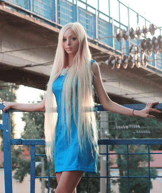 Real life doll Alina Kovalevskaya poses for a photograph on May 29, 2014 in Odessa, Ukraine. Alina Kovalevskaya is a walking, talking, breathing living doll on the lookout for her real-life Ken. (Photo by Aleksey Solodunov/Barcroft Media)