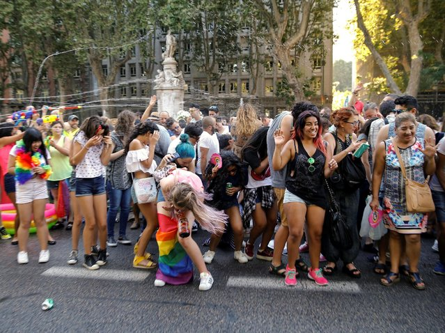 Revellers are sprayed with water during a gay pride parade in downtown Madrid, Spain, July 2, 2016. (Photo by Andrea Comas/Reuters)