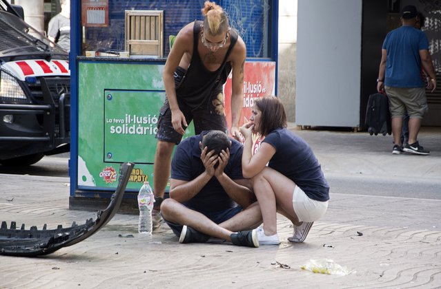 Injured people react after a van crashed into pedestrians in Las Ramblas, downtown Barcelona, Spain, 17 August 2017. (Photo by David Armengou/EPA/Rex Features/Shutterstock)