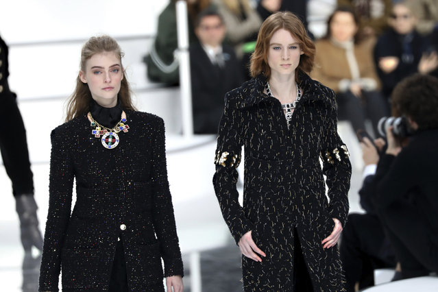 Models wear creations for the Chanel fashion collection during Women's fashion week Fall/Winter 2020/21 presented in Paris, Tuesday, March 3, 2020. (Photo by Vianney Le Caer/Invision/AP Photo)