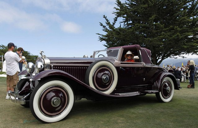 An entrant sits in her 1929 Hispano-Suiza H6B Hibbard & Darrin Cabriolet during the Concours d'Elegance in Pebble Beach, California, August 17, 2014. (Photo by Michael Fiala/Reuters)
