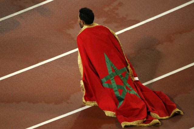 Morocco's Abdalaati Iguider kneels down after finishing third in the men's 1500 metres final during the 15th IAAF World Championships at the National Stadium in Beijing, China August 30, 2015. (Photo by Fabrizio Bensch/Reuters)