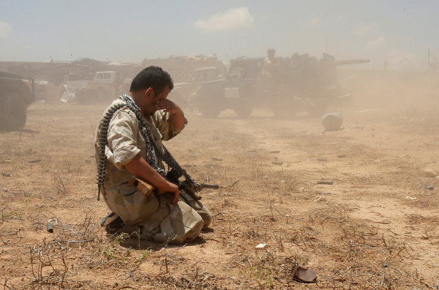 A fighter of Libyan forces allied with the U.N.-backed government takes a break during a battle with IS fighters in Sirte, Libya, July 21, 2016. (Photo by Goran Tomasevic/Reuters)