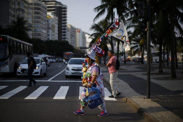 2016 Rio Olympics, Olympic Park on July 29, 2016. Woman wears Olympic themed novelty hat. (Photo by Ivan Alvarado/Reuters)