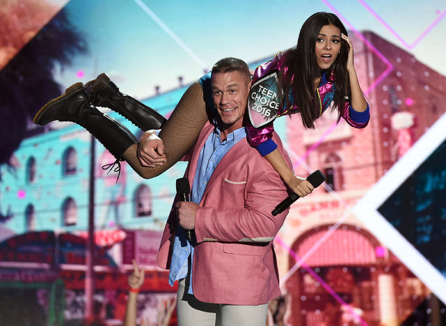 Co-hosts Victoria Justice (L) and John Cena speak onstage during Teen Choice Awards 2016 at The Forum on July 31, 2016 in Inglewood, California. (Photo by Kevin Winter/Getty Images)