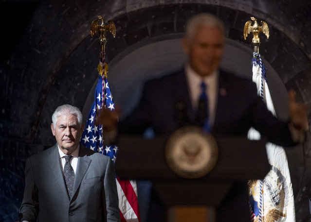 Secretary of State Rex Tillerson, left, listens as Vice President Mike Pence, right, speaks during the first meeting of the National Space Council at the Steven F. Udvar-Hazy Center, Thursday, October 5, 2017 in Chantilly, Va. (Photo by Andrew Harnik/AP Photo)