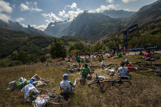 Fans of the Spain La Vuelta race take positions on the mountain to watch the 15th stage between Comillas and Sotres Cabrales, 175,8 kilometers (109 miles),  of the Spanish Vuelta cycling race that finish in Sotres Cabrales, northern Spain, Sunday, September 6, 2015.  Joaquin Rodriguez won the stage. (Photo by Alvaro Barrientos/AP Photo)