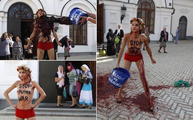 Activists of Ukrainian womens' rights group FEMEN stage a protest at the Kiev Pechersk Lavra monastery in Kiev, September 11, 2014. (Photo by Valentyn Ogirenko/Reuters)