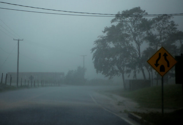 Heavy rain is pictured through the windshield of a car as Hurricane Earl approaches, in Belize City, Belize, August 3, 2016. (Photo by Henry Romero/Reuters)