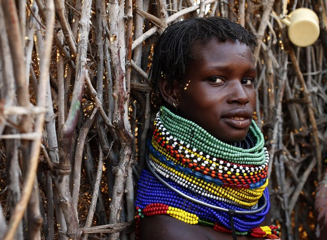 A Turkana woman sits by a hut in Napak village in northwestern Kenya inside the Turkana region of the Ilemy Triangle September 25, 2014. (Photo by Goran Tomasevic/Reuters)