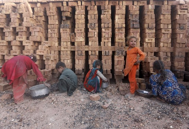 Afghan children work at a brick-making factory outside Kabul, Afghanistan August 20, 2015. (Photo by Mohammad Ismail/Reuters)