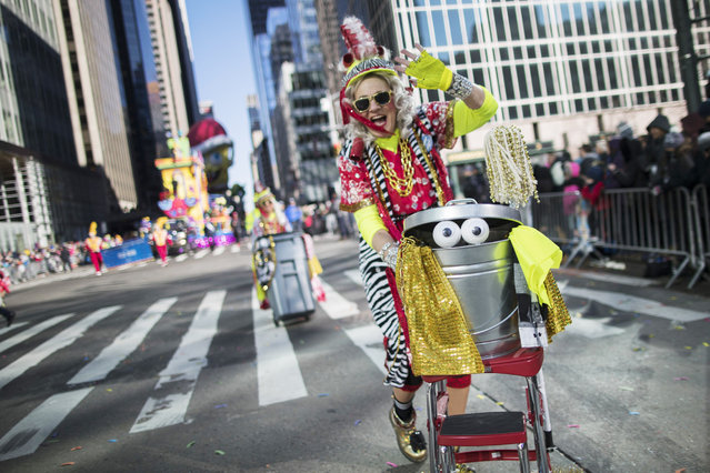 A participant marches down Sixth Avenue during the Thanksgiving Day parade in New York on November 23, 2017. (Photo by Mary Altaffer/AP Photo)