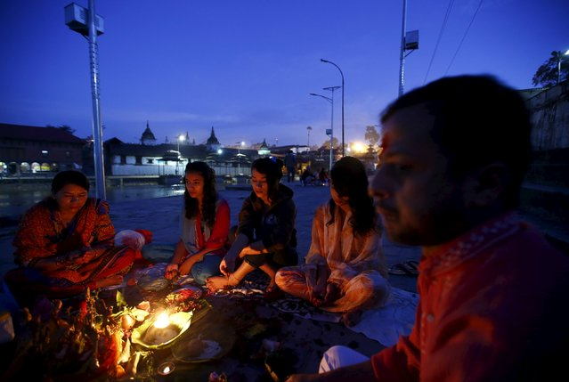 Nepalese women offer prayers along the bank of the Bagmati River, during the Rishi Panchami festival, in Kathmandu, Nepal September 18, 2015. (Photo by Navesh Chitrakar/Reuters)
