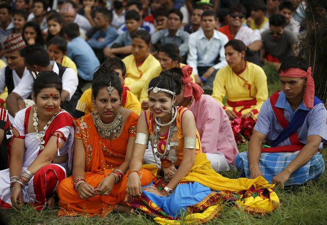 Performers dressed in traditional attire gathers during a celebration a day after the first democratic constitution was announced in Kathmandu, Nepal September 21, 2015. (Photo by Navesh Chitrakar/Reuters)
