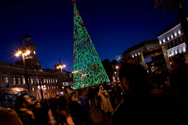 A Christmas tree istands in front of City Hall at the Sol Square in Madrid. (Photo by Emilio Morenatti/Associated Press)