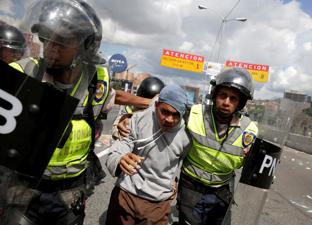 A protester (C) is detained during a rally to demand a referendum to remove Venezuela's President Nicolas Maduro in Caracas, Venezuela, September 1, 2016. (Photo by Marco Bello/Reuters)