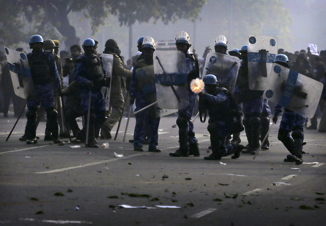 Indian police fire tear gas towards protesters during a violent demonstration near the India Gate in New Delhi, on December 23, 2012. (Photo by Kevin Frayer/AP Photo)