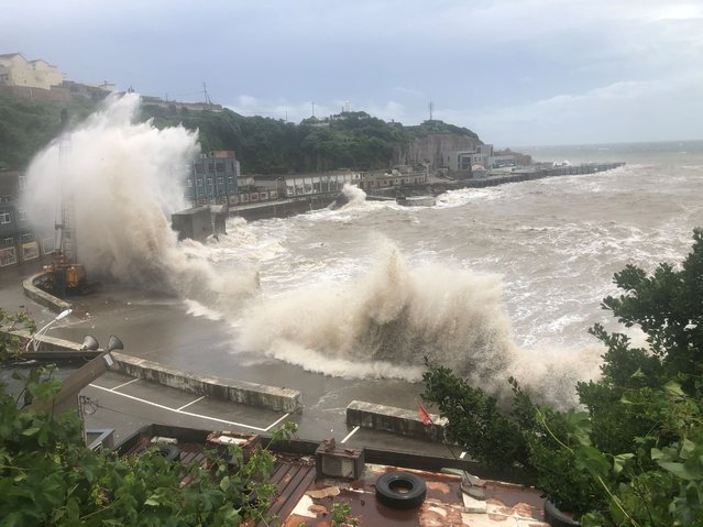 Tens of meters of sea waves affected by typhoon Hagupit, Zhoushan city, Zhejiang Province, China, August 4, 2020. (Photo by Costfoto/Barcroft Media via Getty Images)