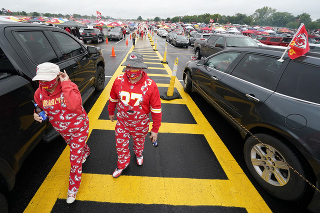 Fans arrive at Arrowhead Stadium before an NFL football game between the Kansas City Chiefs and the Houston Texans Thursday, September 10, 2020, in Kansas City, Mo. (Photo by Charlie Riedel/AP Photo)