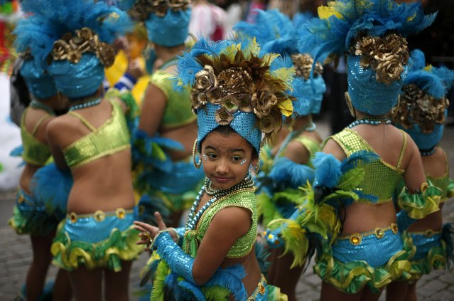 Children wait to take part in a samba parade during the carnival in Sesimbra village  February 10, 2013. (Photo by Rafael Marchante/Reuters)
