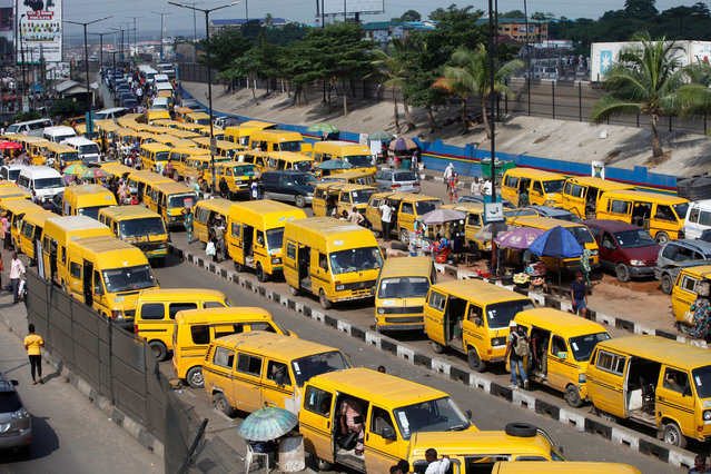 Commercial transport buses painted in yellow queue to take turn in collecting passengers at a motor park in Lagos, Nigeria, 10 September 2020. The price of petrol in Nigeria has been increased within the last three months from slightly above 121 naira($0.32) per liter in June to about 160 naira ($0.41) in September, with rising costs of transportation for commuters. Rights activists have been calling on the government for the reversal of the petrol pump price to no avail. (Photo by Akintunde Akinleye/EPA/EFE/Rex Features/Shutterstock)