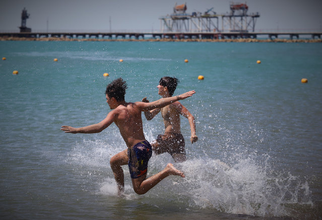 Azerbaijanis enjoy the sunny weather at a beach as the beach season reopens in Baku, Azerbaijan where controlled social life is experiencing due to the coronavirus (Covid-19) on June 16, 2020. (Photo by Resul Rehimov/Anadolu Agency via Getty Images)