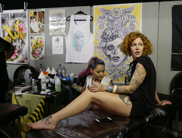 A woman having a tattoo done during the London International Tattoo Convention at Tobacco Dock in London, Britain September 23, 2016. (Photo by Yui Mok/PA Wire)
