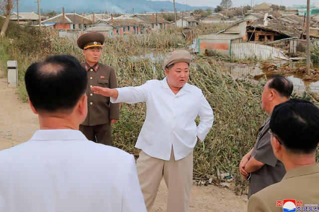 In this picture taken on September 5, 2020 and released from North Korea's official Korean Central News Agency (KCNA) on September 6, 2020 shows North Korean leader Kim Jong Un (C) visits the damaged area made by Typhoon Maysak at South Hamgyong Province. (Photo by KCNA via KNS/AFP Photo/Stringer)