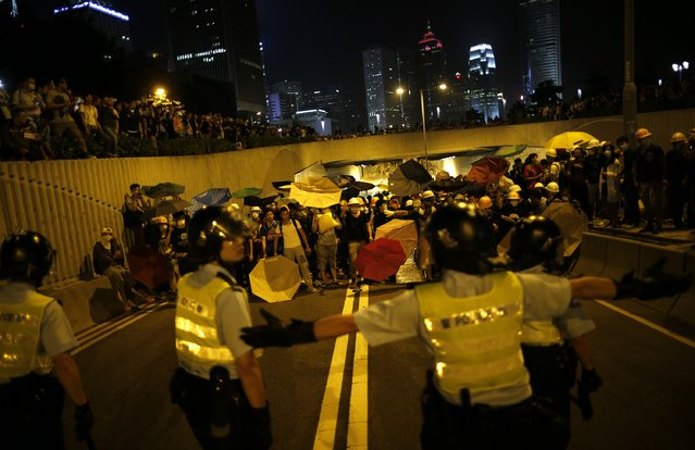 Policemen and pro-democracy protesters engage in a stand-off during a rally close to the chief executive office in Hong Kong, November 30, 2014. (Photo by Tyrone Siu/Reuters)
