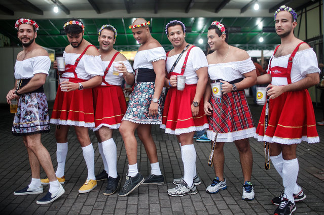 Revellers pose during Oktoberfest on October 25, 2015 in Blumenau, Brazil. The city, founded in 1850 by Dr. Hermann Bruno Otto Blumenau and seventeen other German immigrants, is holding its annual Oktoberfest. An estimated 30 percent of the city's 320,000 residents are of German descent. Its Oktoberfest is one of the largest in the world and attracts hundreds of thousands of people. (Photo by Mario Tama/Getty Images)
