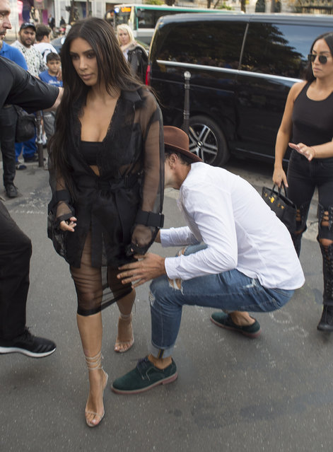 Kim Kardashian's behind is attacked/kissed by Vitalii Sediuk outside L'Avenue restaurant in Paris, France on September 28 2016. (Photo by XposurePhotos.com)