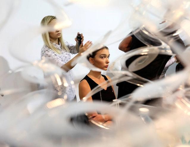 A model has her makeup applied backstage at Ukrainian Fashion Week in Kiev, Ukraine, October 12, 2016. (Photo by Gleb Garanich/Reuters)