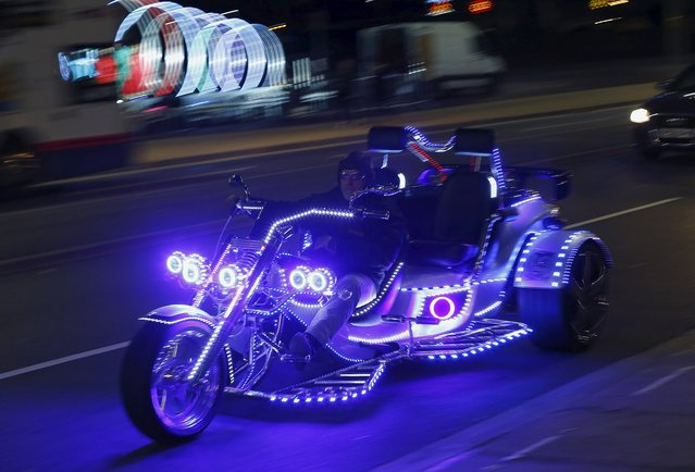 A man rides an illuminated trike during Diwali celebrations in Leicester, Britain November 11, 2015. (Photo by Darren Staples/Reuters)