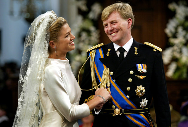 Princess Maxima smiles at Dutch Crown Prince Willem-Alexander during their wedding ceremony in the Nieuwe Kerk, or New Church, in Amsterdam, February 2, 2002. (Photo by Jerry Lampen/Reuters)