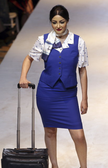 A model exhibits clothes from the 70 years of Tunisair crew uniforms presentation during the Tunis Fashion Week 2018 in Tunis, Tunisia, 12 May 2018. (Photo by Mohamed Messara/EPA/EFE)