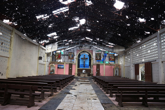 The interior of a bullet-riddled Catholic church is seen in Marawi, southern Philippines on May 23, 2018. (Photo by Neil Jerome Morales/Reuters)