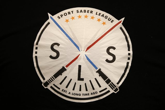 The logo of the Sport Saber League is seen on back of an instructor's tee-shirt during a light saber training session in Paris, France, November 9, 2015. (Photo by Charles Platiau/Reuters)