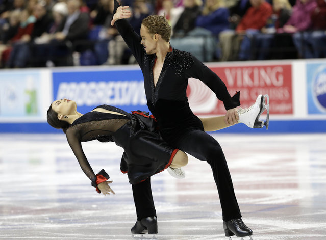 Madison Chock, left, and Evan Bates perform during their short dance program in the U.S. Figure Skating Championships in Greensboro, N.C., Friday, January 23, 2015. (Photo by Gerry Broome/AP Photo)