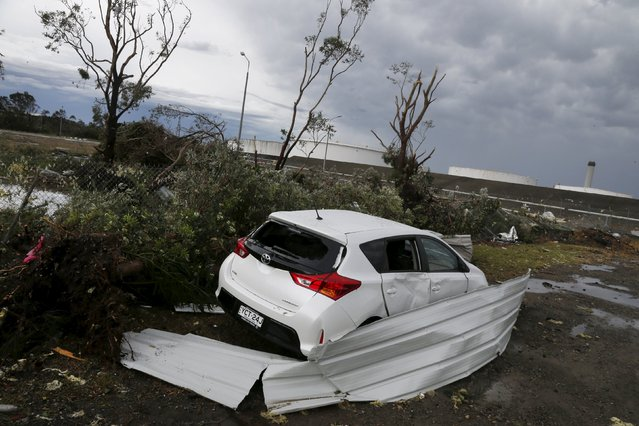 A car sits among factory roof debris with its windows smashed alongside an oil refinery following a rare tornado in the Sydney suburb of Kurnell, December 16, 2015. (Photo by Jason Reed/Reuters)