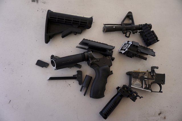 Seized weapons are seen after being destroyed by the authorities of the General Directive for the Control of Weapons and Munitions, (DIGECAM), in Guatemala City, December 17, 2015. (Photo by Jorge Dan Lopez/Reuters)