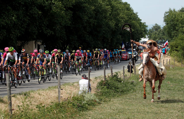 A man rides his horse alongside the pack during the thirteenth stage of the Tour de France cycling race over 169.5 kilometers (105.3 miles) with start in Bourg d' Oisans and finish in Valence, France, Friday July 20, 2018. (Photo by Benoit Tessier/Reuters)